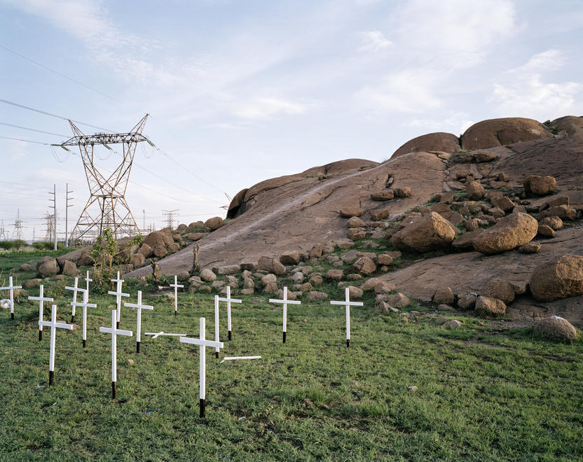 Thirty-Four White Wooden Crosses from Legacy of the Mine, 2011–2013, by Ilan Godfrey