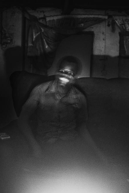E smiles at me during a family reunion from the Uncanny, 2013 by Léonard Pongo